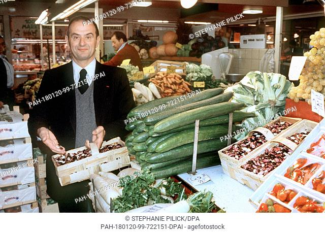 An archive photo from 27 October 1979 shows famous French chef Paul Bocuse shopping at a fresh food market. France's Interior Minister Collomb informed the...