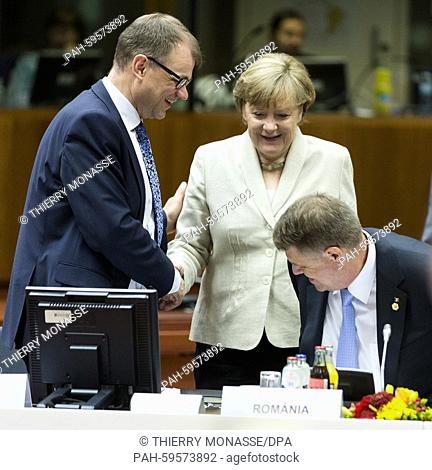 Brussels, Belgium, June 26, 2015. -- Finish Prime Minister Juha Sipilä (L) is talking with the German Chancellor Angela Merkel (C) and the Romanian Prime...