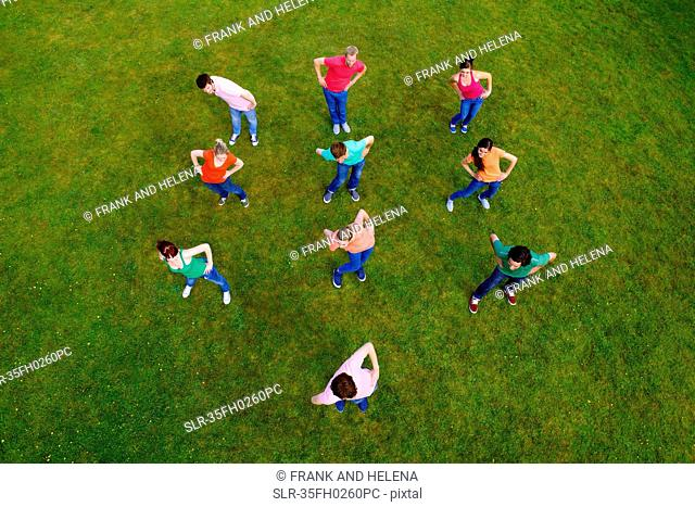 People stretching together in grass