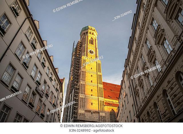 A beautiful sunlit clock tower in Munich, Germany