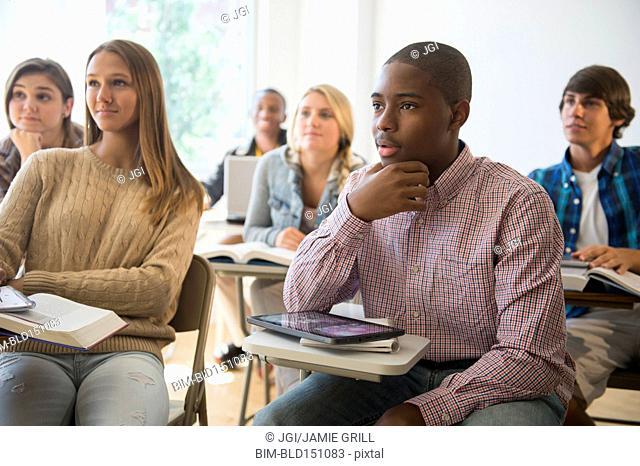 Teenage students listening in classroom