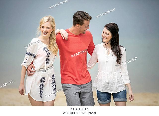 Three friends having fun on the beach
