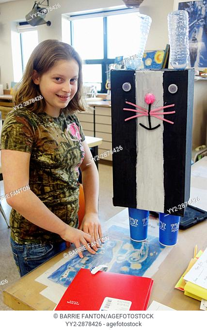 6th Grade Girl With Art Project, Wellsville, New York, USA