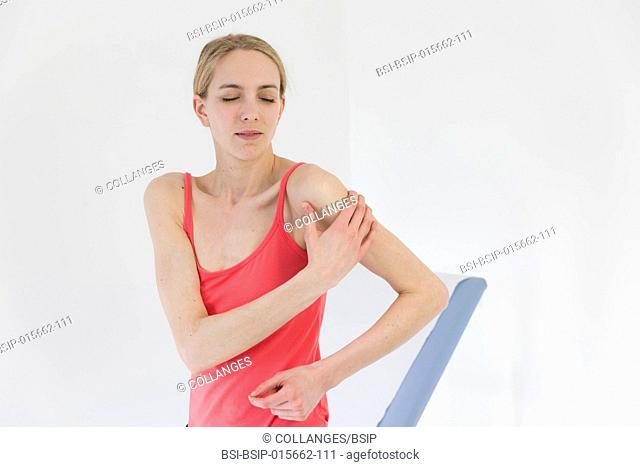 Female patient consulting for shoulder pain