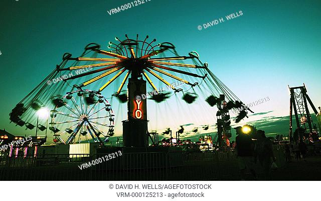 Amusement ride at twilight at summer fair in Windsor, Maine