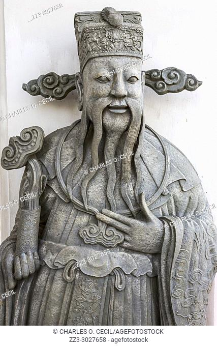 Bangkok, Thailand. Chinese Guardian Statue at Exit from Wat Pho Temple, the Reclining Buddha