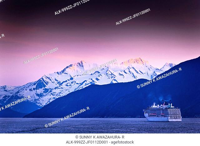 Carnival Cruise Spirit sailing through Lynn Canal at sunset, near Haines, Inside Passage, Southeast Alaska, Summer
