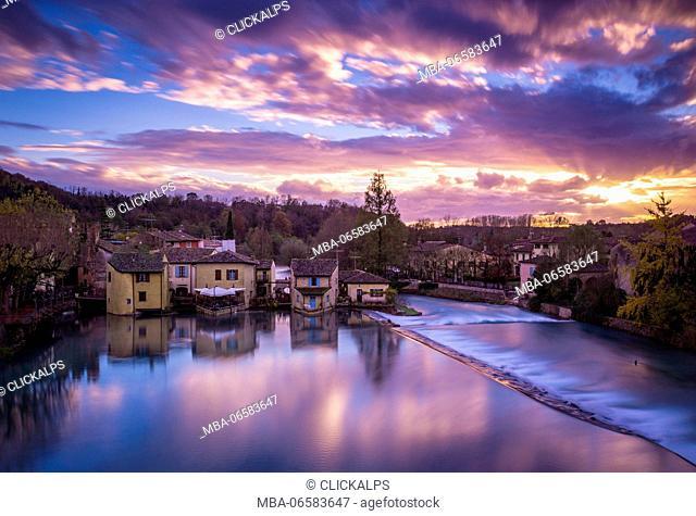Valeggio sul Mincio, Veneto, Italy, Landscape view of the village during a colorful sunset