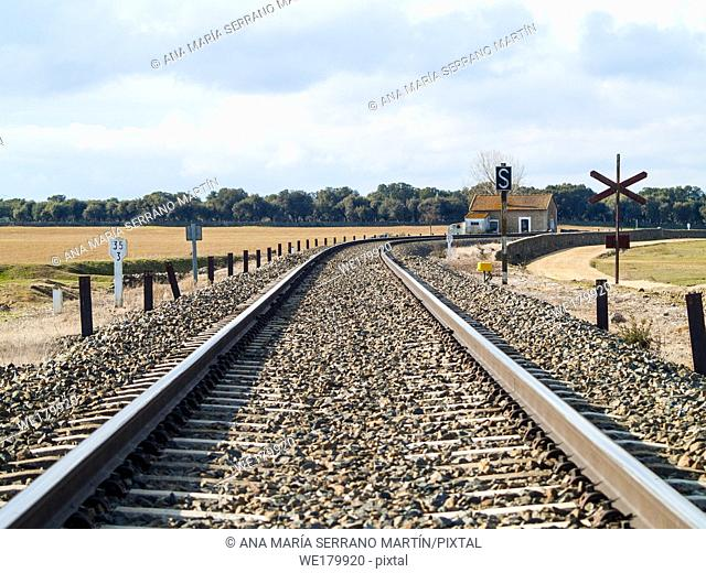 Rural landscape of a railway track and a small railway station