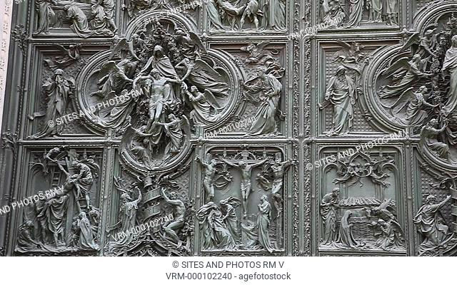 Exterior, CU, PAN, daylight, view of the main cathedral door. Seen are the bronze carvings made by Ludovico Pogliaghi between 1906-1908