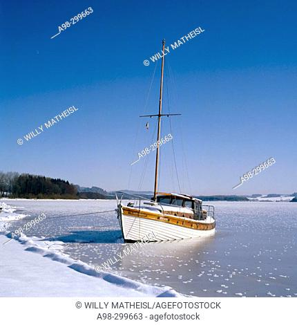 Boat on ice. Moldaustausee. Czech Republic