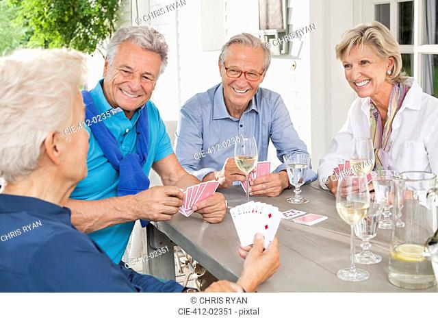 Friends playing card games at table
