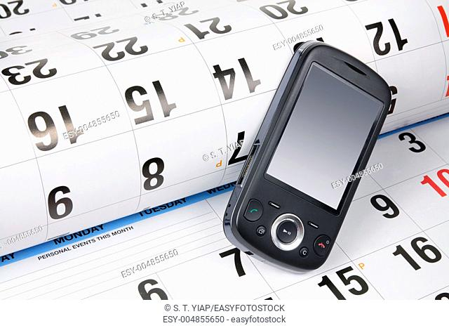 Close Up of Smart Phone on Calendar