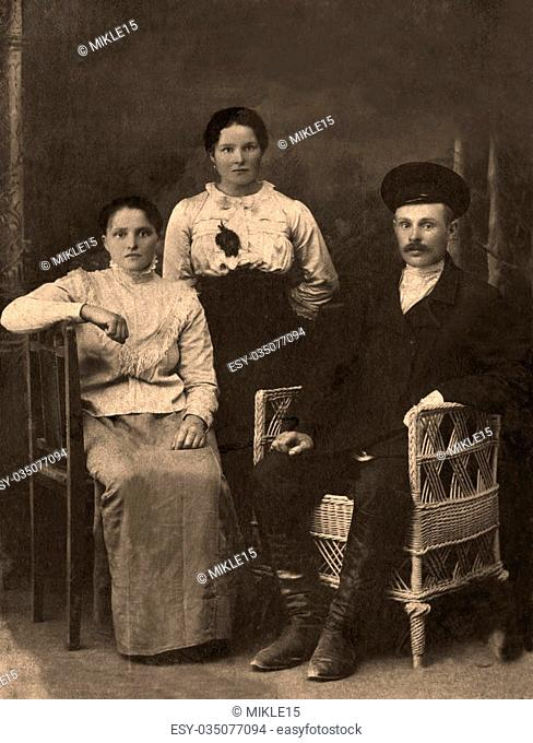 A vintage photo portrait from 1912 of Russian family