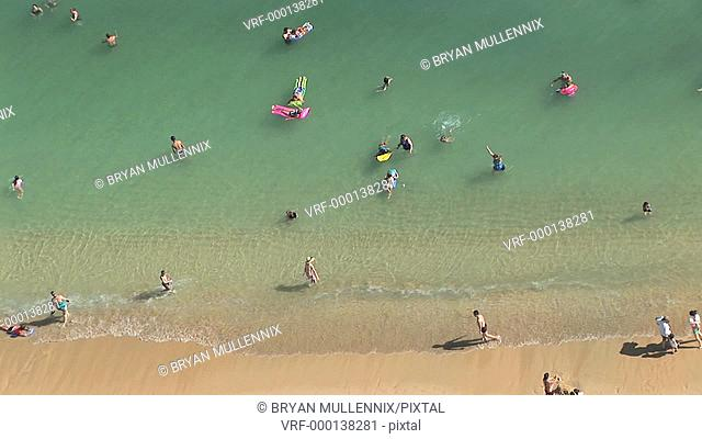High angle view of tourists on the beach in Waikiki, Honolulu, Hawaii