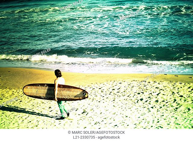 Surfer on the beach. Barcelona, Catalonia, Spain