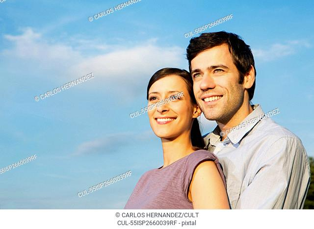 Portrait of mid adult couple, looking away