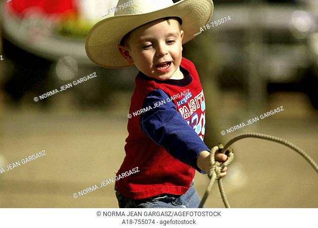 A young cowboy practices roping at a rodeo in Tucson, Arizona