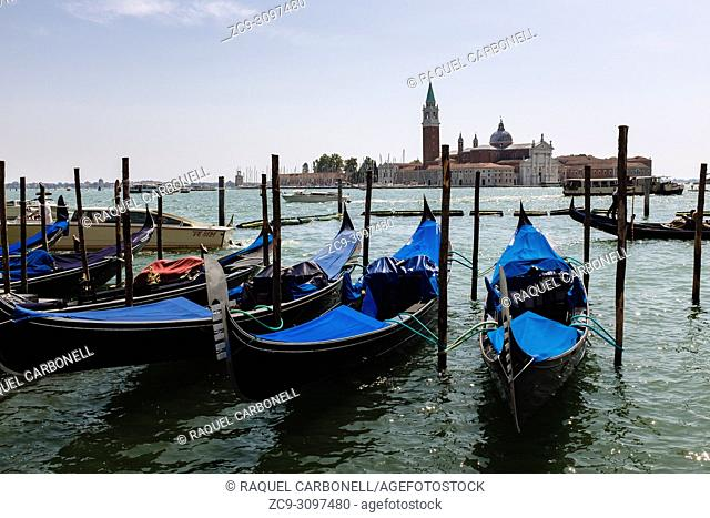 Gondolas on the lagoon with Church of San Giorgio Maggiore at back, Venice, Veneto, Italy