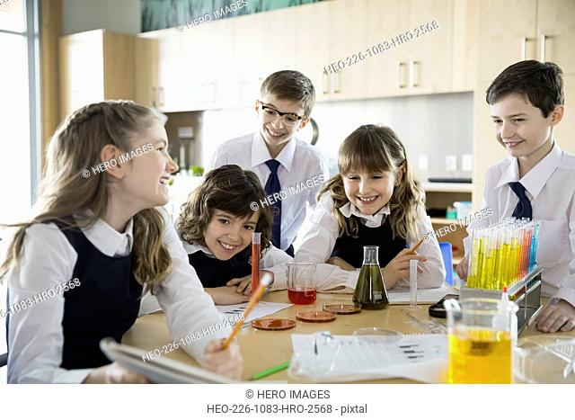 Elementary students conducting experiment in science classroom