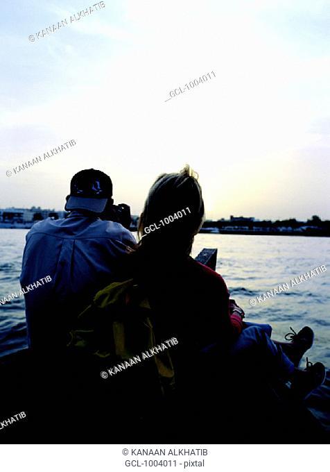 Western couple on an abra on the creek in Dubai, United Arab Emirates