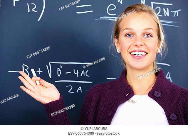 Education - Joyful female teacher teaching algebra