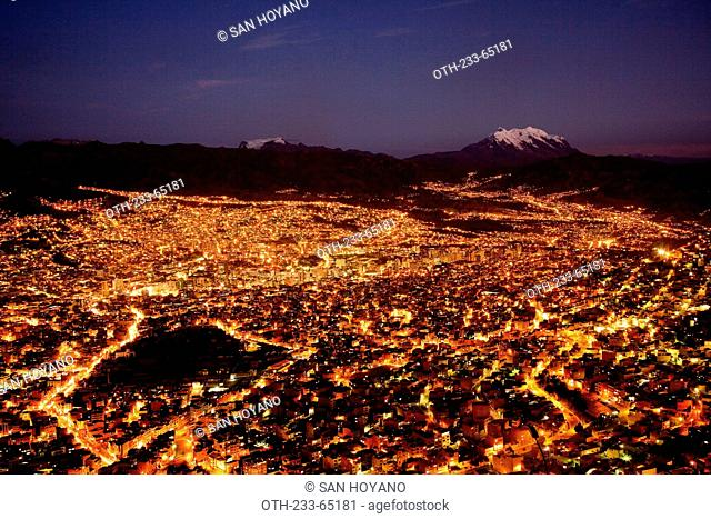 Cityscapes of La Paz and Nevado Illimani viewed from El Alto at night, Bolivia, South America