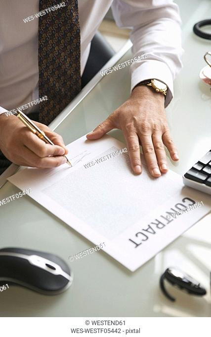Business man signing contract, close-up
