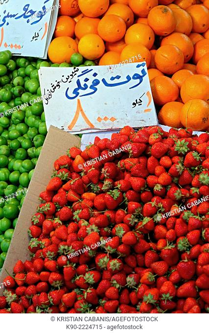 A mountain of fresh strawberries and other fruits on a farmers market, Tehran, Iran, Asia