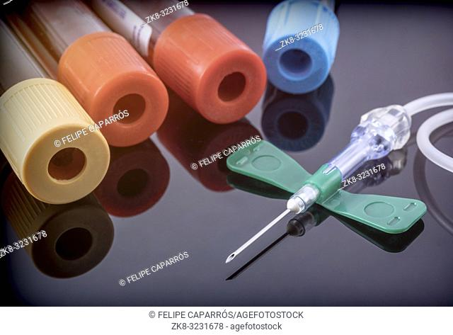 Several blood samples along with needle, conceptual image