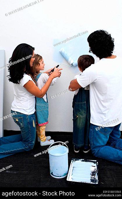 Loving parents helping their children paint