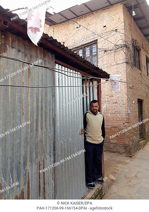 Manik Shakya stands at the entrance of his corrugated-iron hut in Bungamati, a suburb of Kathmandu, Nepal, 05 December 2017