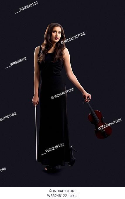 Woman holding a violin