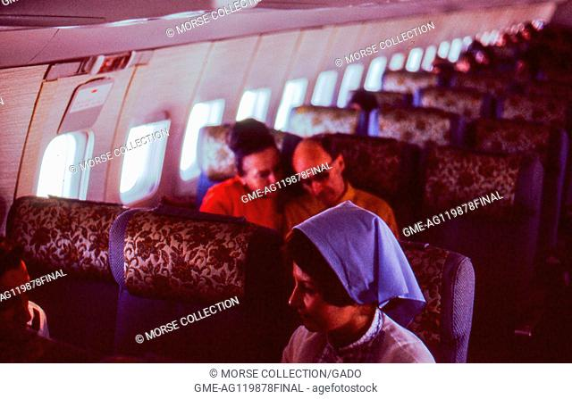 Interior view of a Turkish Airlines airplane with seated travelers, in Istanbul, Turkey, November, 1973