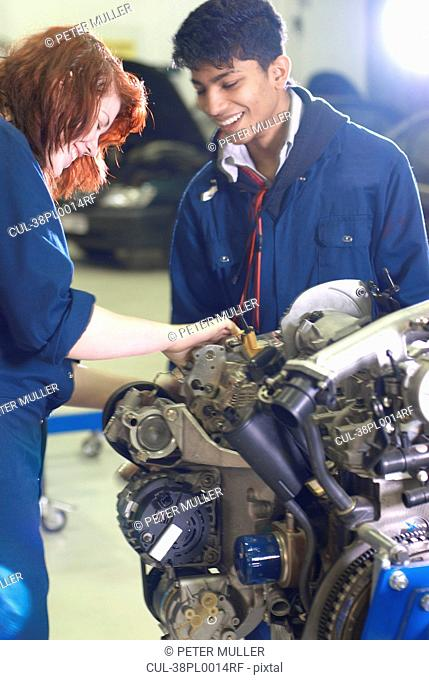 Students working on car engine