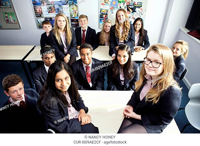 Group portrait of teenage schoolchildren in class