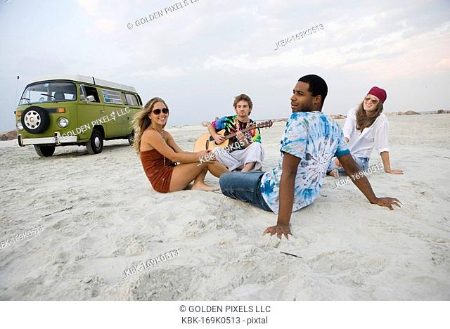 Hippies hanging out at the beach