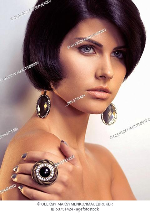 Beauty portrait of a young glamorous woman wearing jewellery