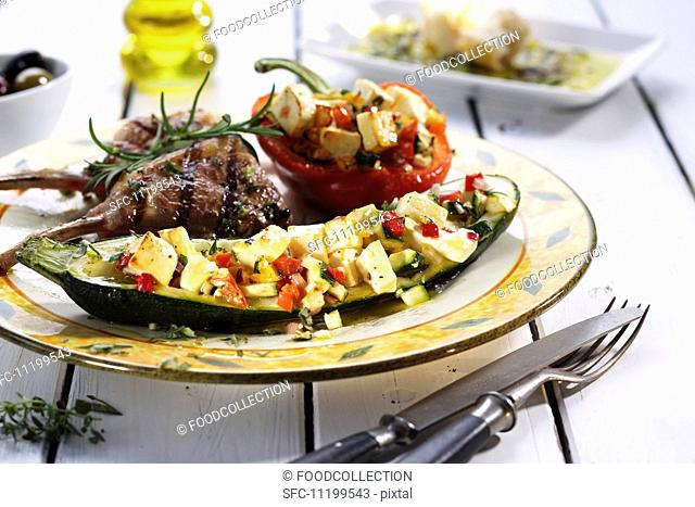 Courgette and peppers stuffed with sheep's cheese, and lamb chops