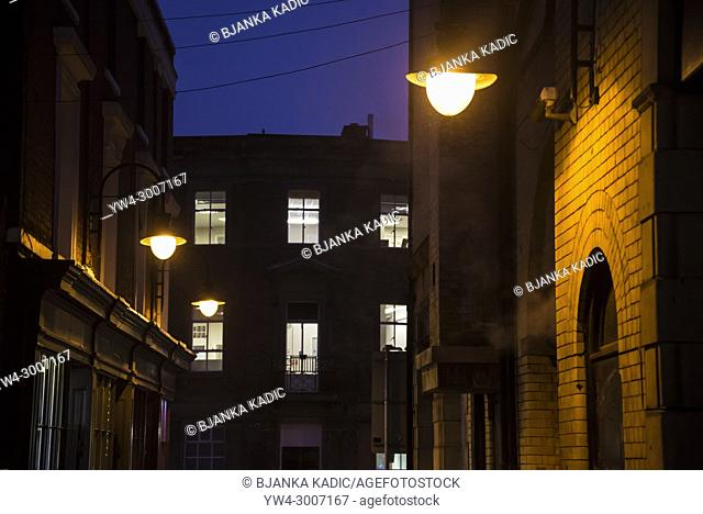 Street at night with street lamps and lit windows, Wolverhampton, Midlands, England, UK