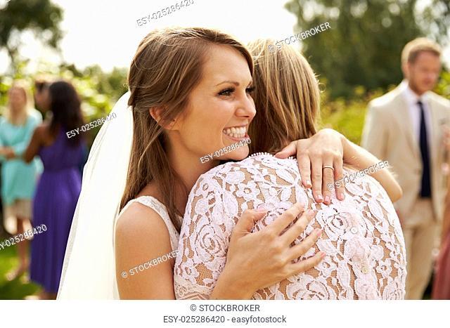 Bride Hugging Mother On Wedding Day
