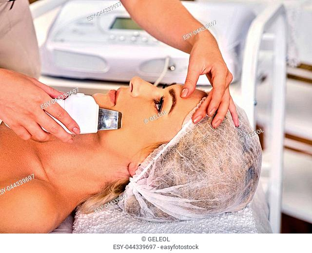 Skin care of ultrasound facial peeling. Ultrasonic cleansing procedure. Crop of beauty treatment of woman. Beauty cosmetology in spa salon