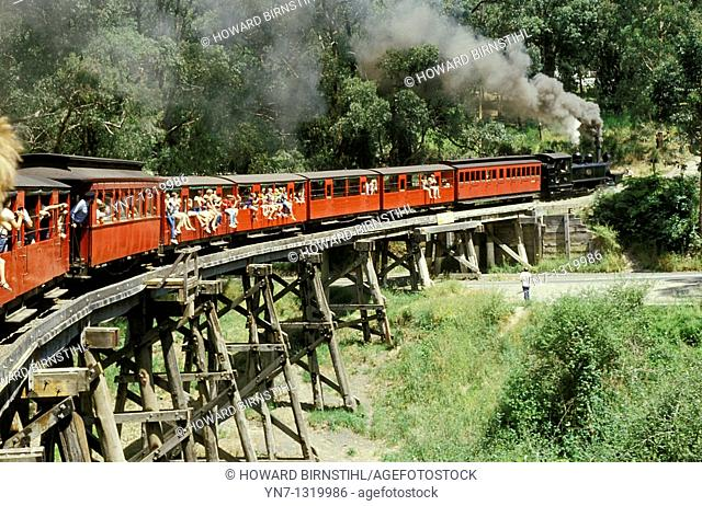 Puffing Billy steam train crossing a large trestle bridge