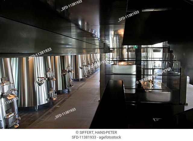 Chateau Pedesclaux: wine being moved to different levels with four tank lifts (Bordeaux, France)