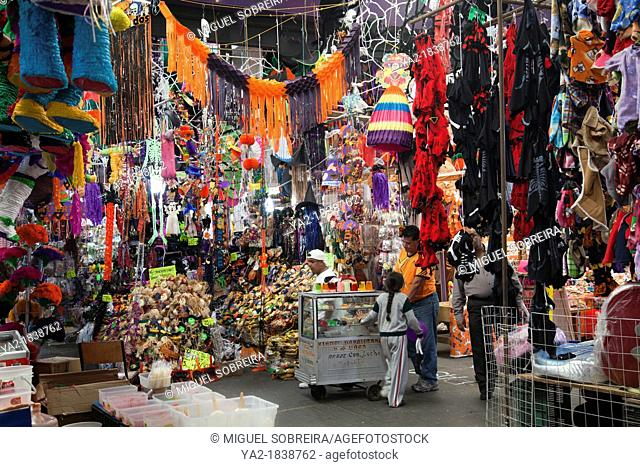Merchandise for Halloween and Día de los Muertos at a stall in Jamaica Market in Mexico City DF