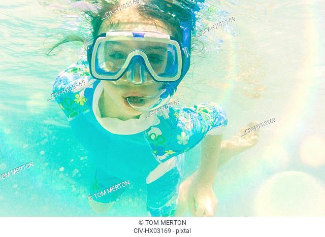 Portrait girl snorkeling underwater