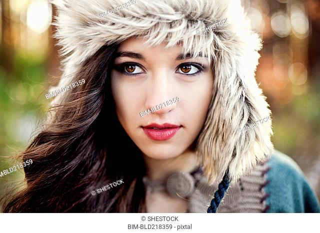 Close up of serious woman wearing furry hat