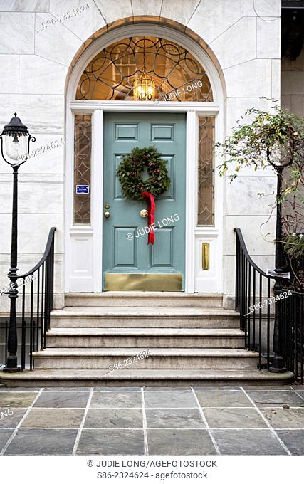Christmas Wreath Decorating the Door of an Upper East Side, New York City, Townhouse