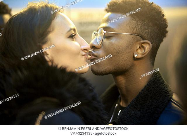 young couple kissing, in Munich, Germany