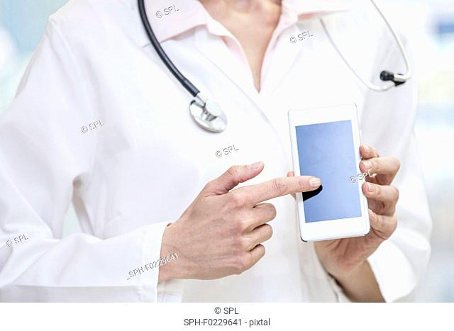 Doctor holding mobile phone